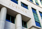 Building Exterior with Justice on it