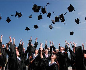 Graduation hats thrown in air