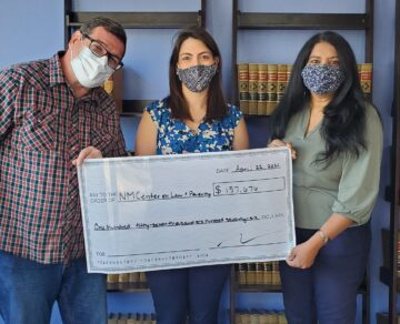 3 Adults Holding Large Check